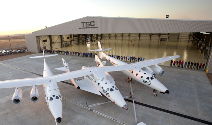 THE SPACESHIP COMPANY unveils its new and first final assembly facility. The hangar known as FAITH- (Final Assemmbly Integration Test Hangar). In the foreground is the mated pair, WhiteKnnight Two and SpaceShip Two.